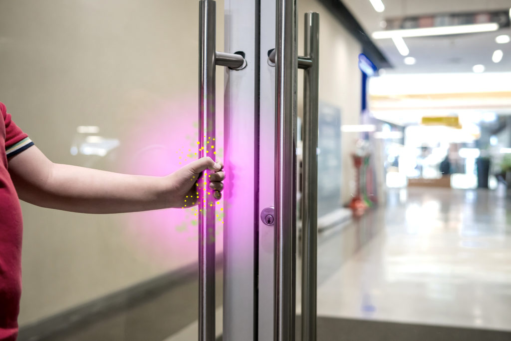 Commercial door with bacteria and germs needs disinfection