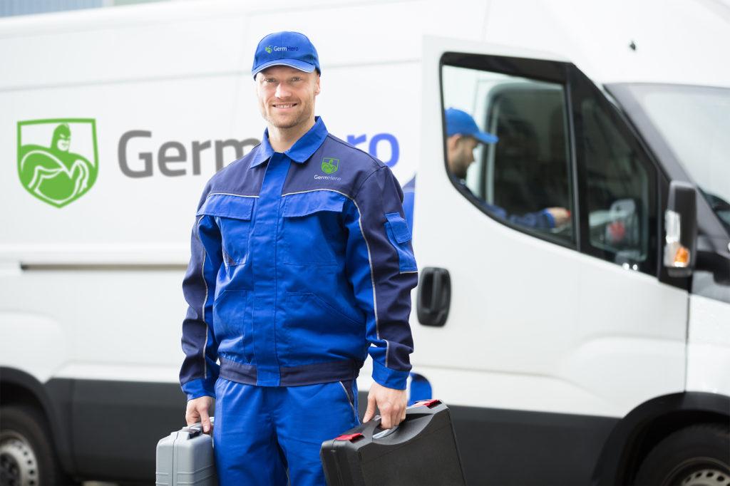 Germ Hero Technician Smiling in front of Germ Hero Truck