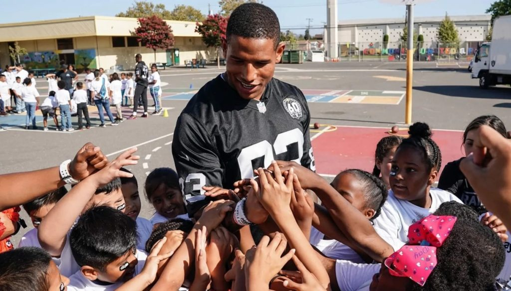 Photo of Darren Waller with Children