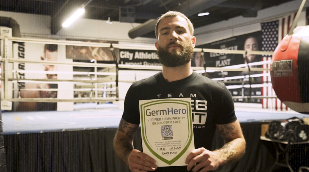 Caleb Plant Holds Up Germ Hero Sign